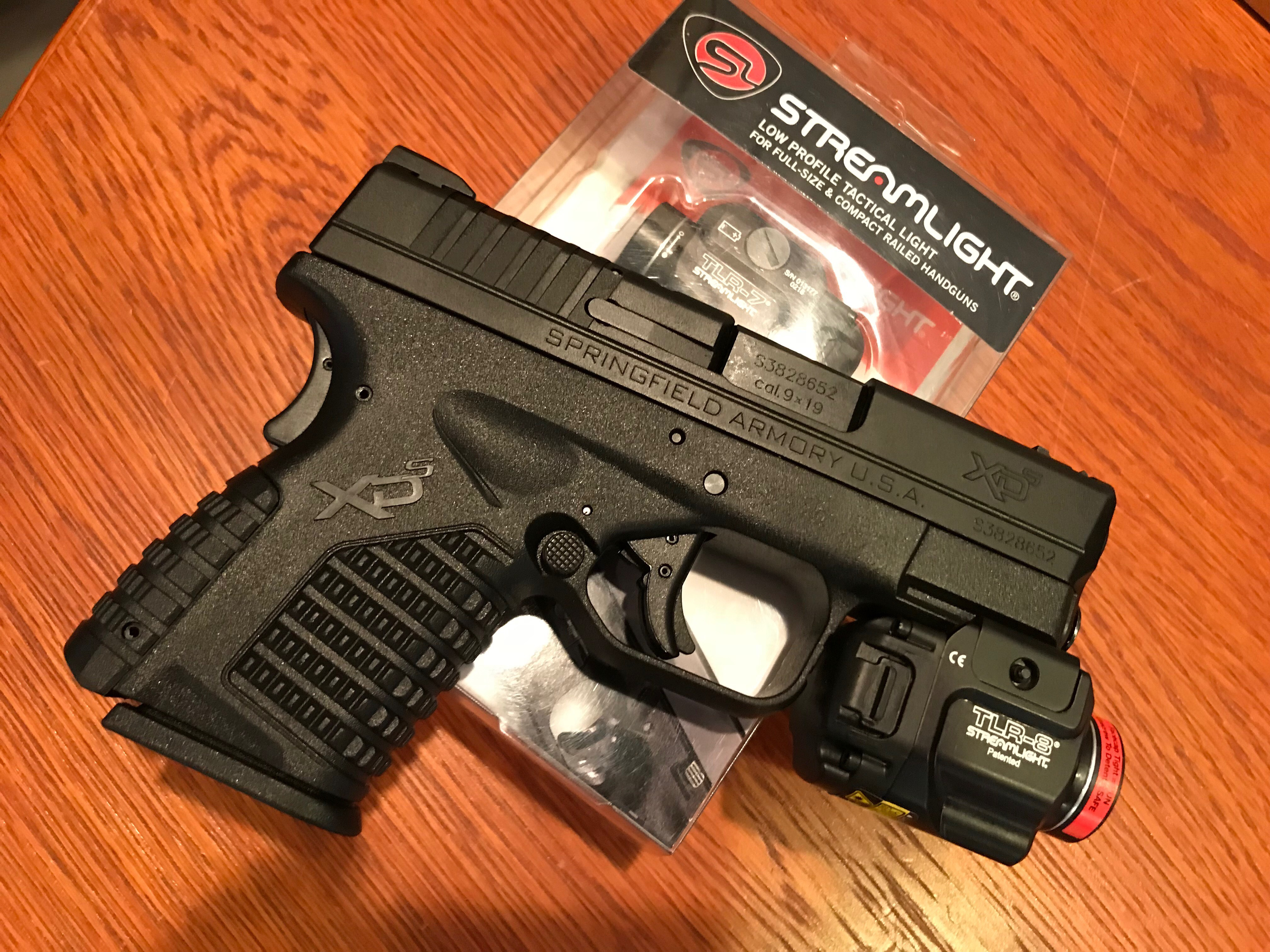 A Streamlight TLR-8 on a Springfield XDs