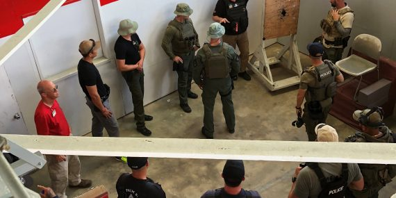 Team One Network Conducts Shoot House Instructor Courses - John Meyer explains bullet traps to students during the course.